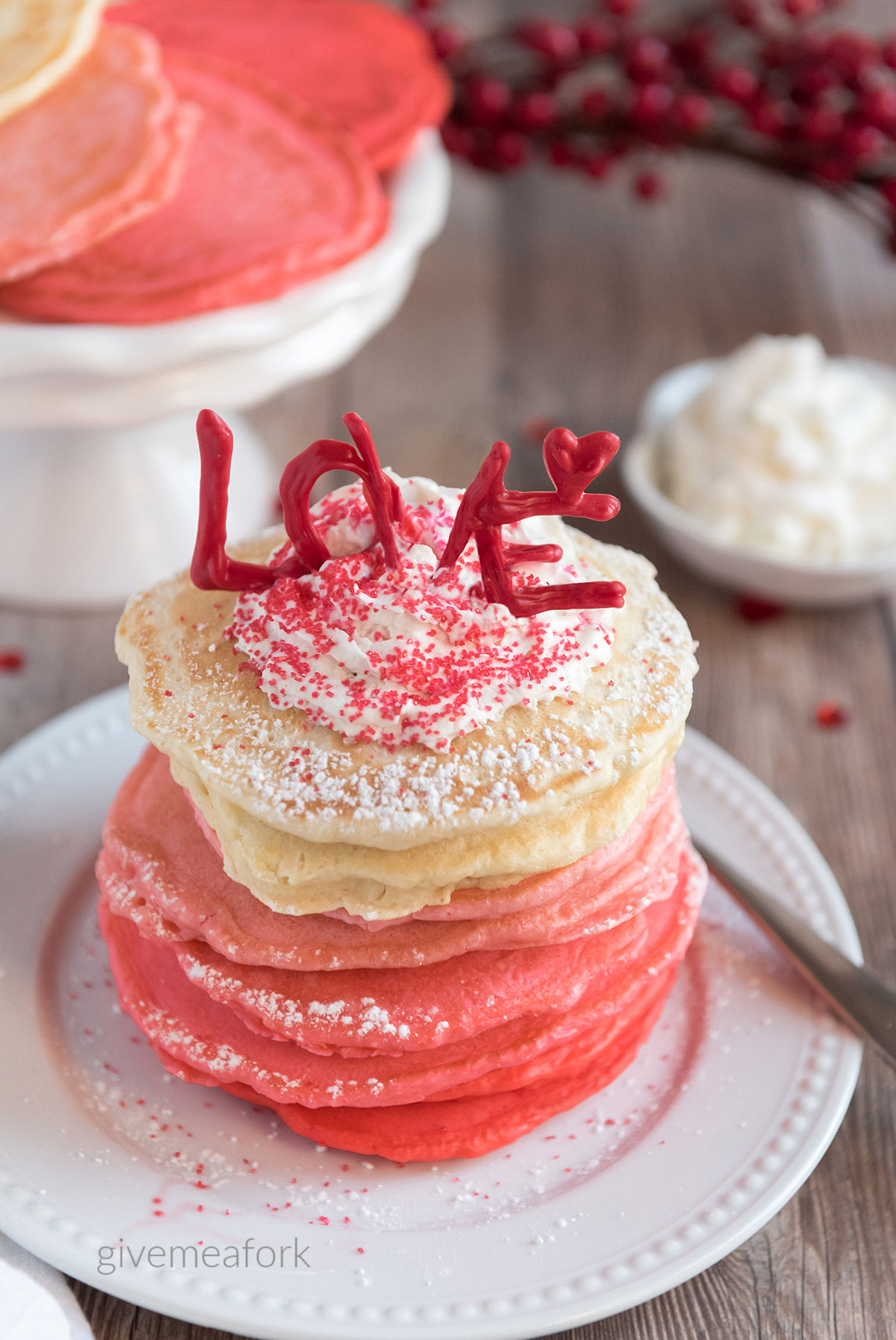pink ombre pancakes on a white plate