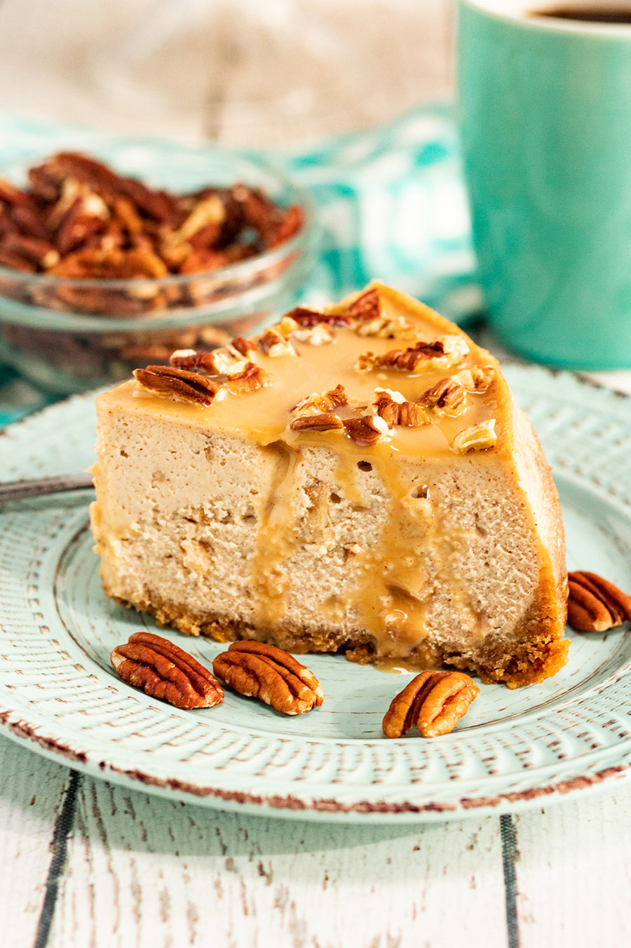 a slice of caramel apple cheesecake with pecans.