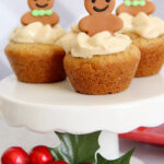 three gingerbread cheesecake cookie cups on a white cake stand.