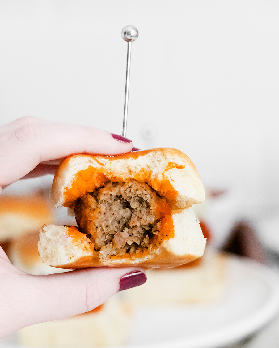 a bitten meatball slider up close.