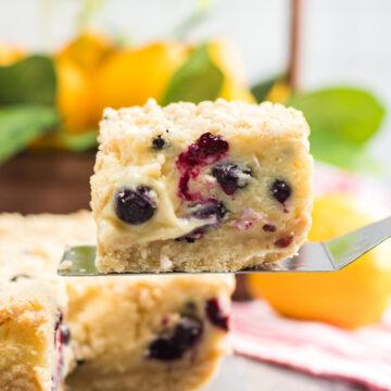 a slice of lemon blueberry cream cake up close.