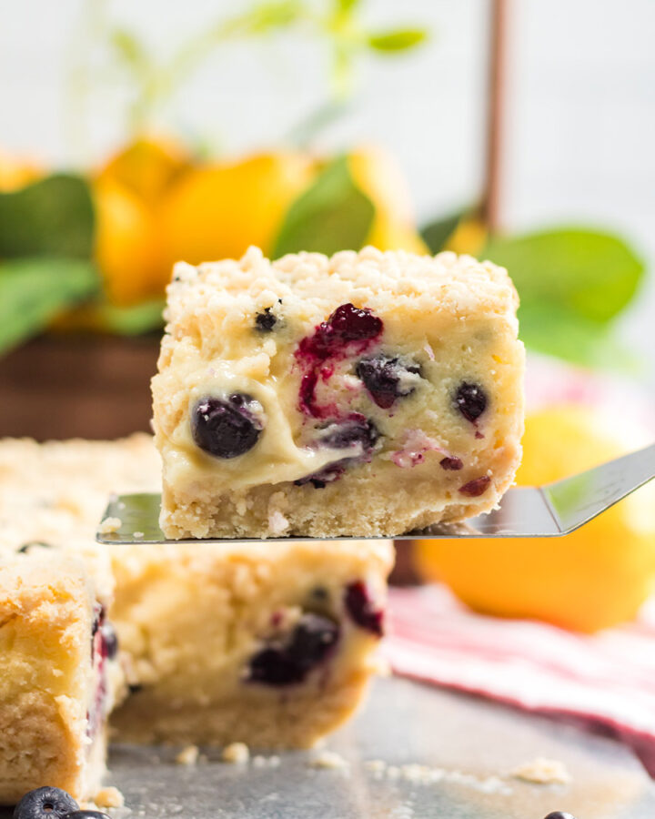 a slice of lemon blueberry cream cake up close.