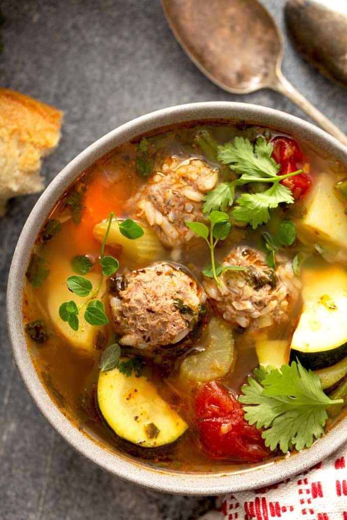 albondiga soup with herbs and squash.
